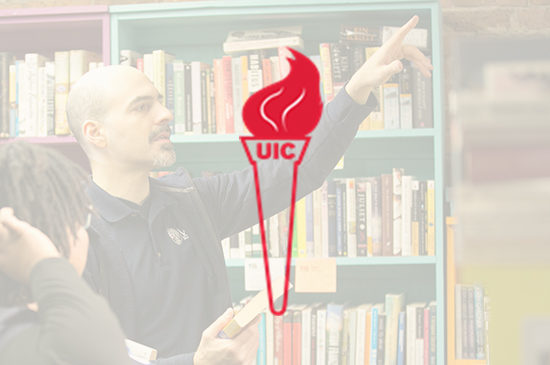 Torch with UIC on handle with image of guest speaker in background
