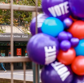 Student Center East in background with vote balloons on foreground
