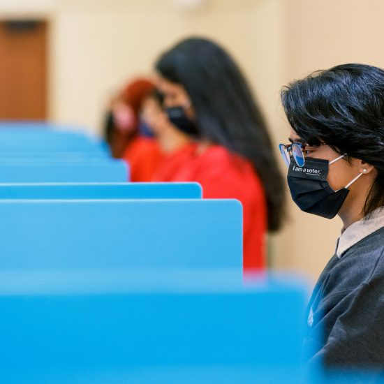 Students in voting booths wearing masks