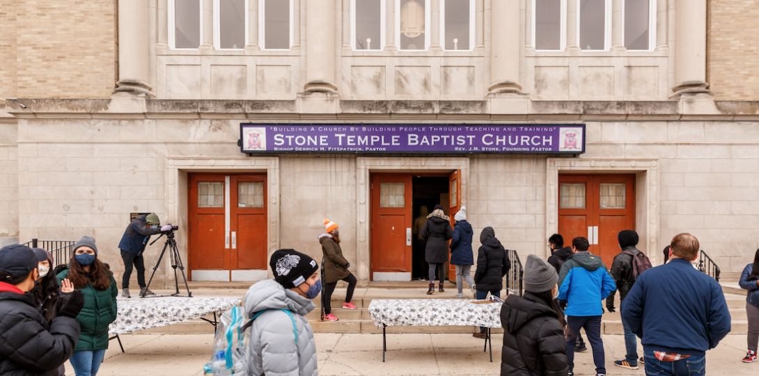 People waiting in line to enter Stone Temple Baptist Church