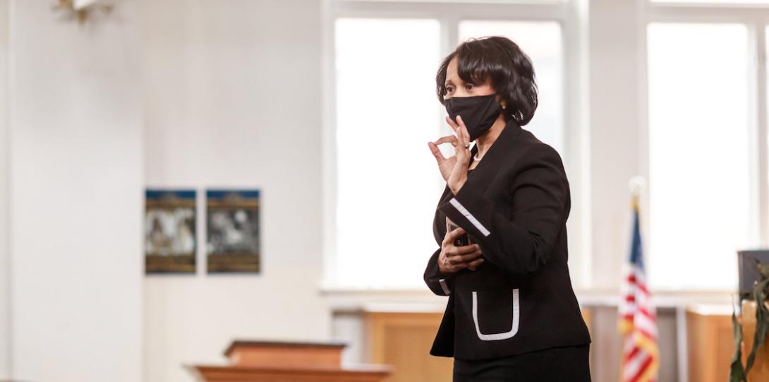 A women speaking inside a building.